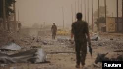 یکی از اعضای «نیروهای دمکراتیک سوریه» در رقه