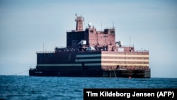 The world's first floating nuclear power plant, Russia's Academy Lomonosov, travels on the way to Murmansk.