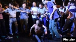 Armenia -- A 58-year-old man, Kajik Grigorian, is pictured moments after setting himself on fire during an opposition demonstration on Marshal Bagramian Avenue in Yerevan, 30Jul2016