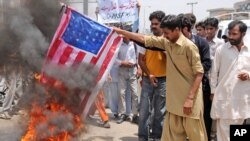 Supporters of Pakistan's Muslim League burn a representation of the U.S flag during an anti-American demonstration in May.