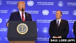 U.S. President Donald Trump (left) speaks to a press conference in New York in September 19 as Secretary of State Mike Pompeo looks on.