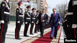 The head of the North Caucasus Federal District Aleksandr Khloponin (left) and Chechen Republic head Ramzan Kadyrov arrive for a ceremony to inaugurate Kadyrov for a second term as Chechen president in Grozny in 2011.