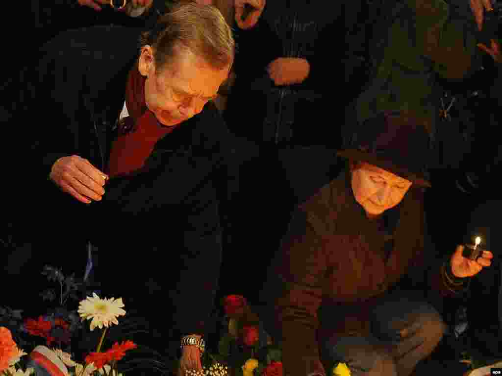 Havel (left) lights candles at the students' memorial on National Avenue in Prague on November 17, 2009.