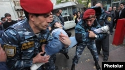Armenia -- Riot police arrest an anti-government protester in Yerevan, 5Nov2013