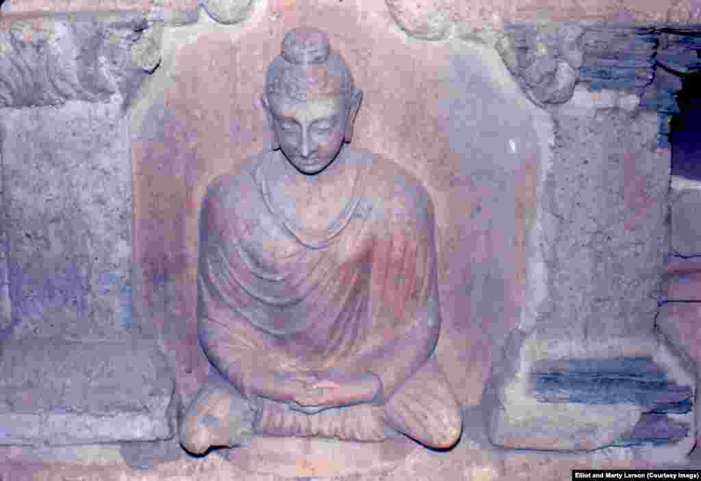 "A statue of the Buddha in a cave complex near Jalalabad. Elliot notes that ""at that time the remains were strikingly well-preserved."" Statues at the site have reportedly been destroyed."