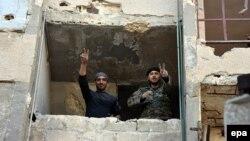 Сириялык аскерлер Алеппонун жанындагы Ханано конушунда, 27-ноябрь.
