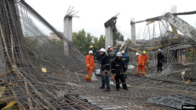Rescue workers at the scene of the collapse on October 25.