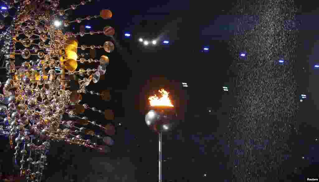 The Olympic flame is pictured before being extinguished during the closing ceremony.