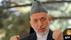 Afghan President Hamid Karzai complained that NATO officials in Afghanistan sometimes behave as if they are occupiers rather than allies with the government in Kabul.