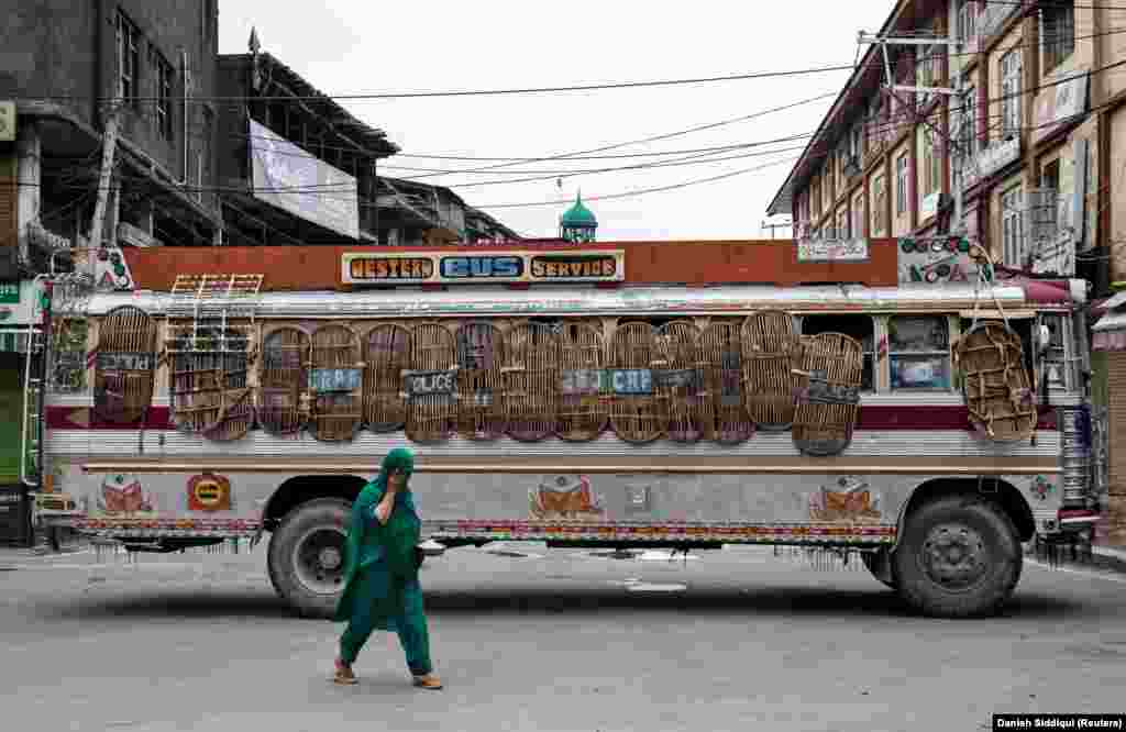 A police bus blocks a street in Kashmir. Leaders in Kashmir have warned of a violent response to the stripping of its autonomy in a region where militants have been fighting against Indian rule for nearly 30 years, a conflict that has killed more than 50,000 people.
