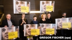 German actresses Meret Becker (3rd left) and Katja Riemann (3rd right) take part in a protest by Amnesty International for the release of Ukrainian director Oleh Sentsov during the 66th annual Berlin International Film Festival in Berlin in February 2016.