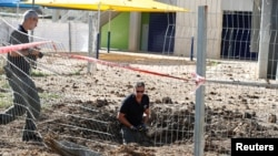 Полицейские на месте обстрела в Кирьят-Гефе, Израиль, 4 мая 2019 года