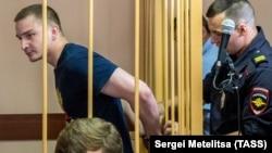 Maksim Yablokov (left) is shown at a court hearing in Yaroslavl on July 25, 2018.