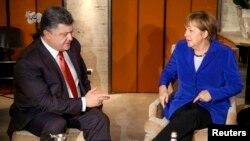 Президент України Петро Порошенко та канцлер Німеччини Ангела Меркель, архівне фото