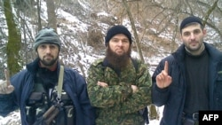 North Caucasus insurgency leader Doku Umarov (center) poses with Emir Muslim (left) and Emir Imam.