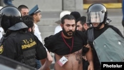Armenia - Karo Sahakian, a photojournalist for Panarmenian.net, is detained by police in Yerevan, 23Jun2015.