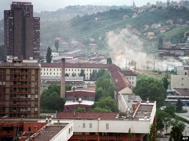 Shells hit houses in the suburbs of Sarajevo in August 1992.