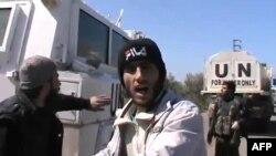 Кадр із відеозвернення повстанців, які захопили заручників, 6 березня 2013 року