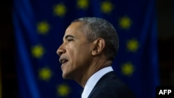 U.S. President Barack Obama warns that Russian President Vladimir is trying to undermine European unity.