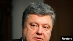 Ukraine -- Petro Poroshenko, the billionaire owner of Ukrainian chocolate manufacture Roshen, and front-runner in Ukraine's presidential election, listens during an interview with Reuters in Kiev in this April 4, 2014 file photo.