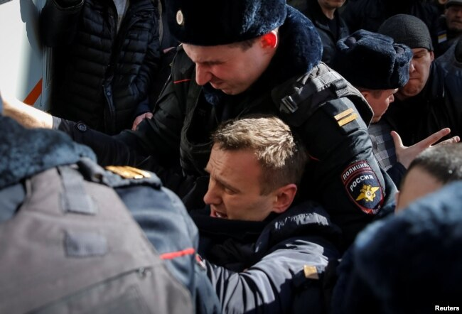 Russian police detain opposition leader Aleksei Navalny on March 26.