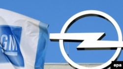 A General Motors flag flies next to the Opel logo at the carmaker's plant in Bochum, Germany.