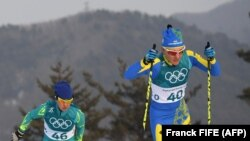 Казахстанка Елена Коломина (под номером 46) на состязаниях по скиатлону в Пхенчхане. 10 февраля 2018 года.