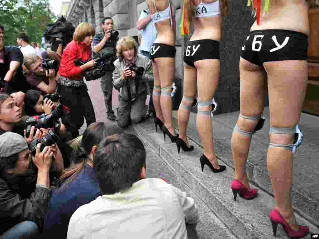 "Activists from the Ukrainian women's movement FEMEN wear underwear and bras reading ""SBU Bitches,"" as they block the entrance of the Ukrainian Secret Services (SBU) building during a protest in Kyiv on June 23 against lawlessness in the country. (Photo by Sergei Supinsky/AFP)"