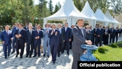 Azerbaijani President Ilham Aliyev (front), who took over from his father, attending a ceremony to mark new water supplies to the city of Kurdamir.