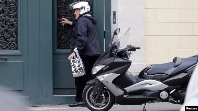 French actor Gerard Depardieu enters his Paris home in December, one month after the scooter accident that stemmed the drunk-driving charge.