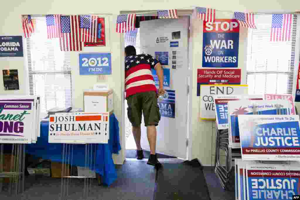 Volunteer peeks outside the Pinellas County Democratic Party headquarters in St. Petersburg, Florida.