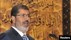 Египет президенті Мұхаммед Мурси. 12 тамыз 2012 жыл.