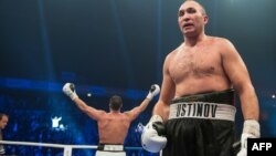 Germany's Manuel Charr (left) celebrates after winning the WBA world heavyweight boxing title in a bout against Russia's Aleksandr Ustinov (right) on November 25.