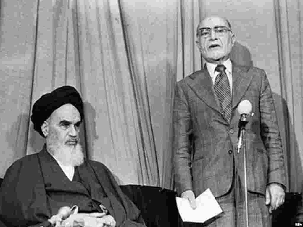 Khomeini introduces Mehdi Bazargan as interim prime minister during the Islamic revolution in February 1979.