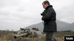 Russian President Dmitry Medvedev takes pictures during his visit to Kunashiri Island, one of the four islands in dispute, on November 1.