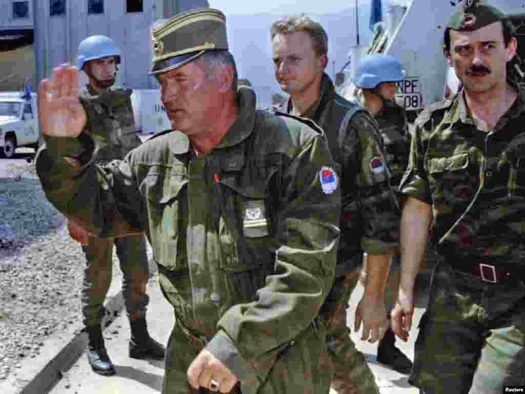 Mladic arrives at Sarajevo's airport on August 6, 1993, to discuss the possibility of opening two supply roads to Sarajevo and the withdrawal of Bosnian Serb troops from Mt. Igman.