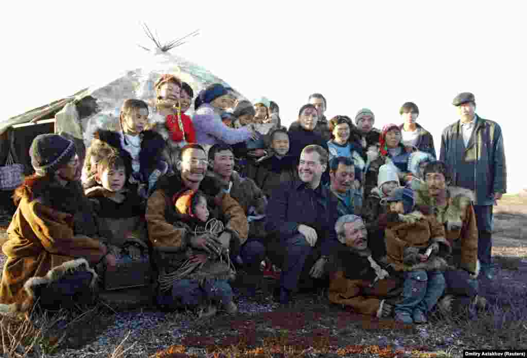 On September 23, 2008, Medvedev poses with reindeer herders in the town of Kanchalan in Russia's Chukotka region.