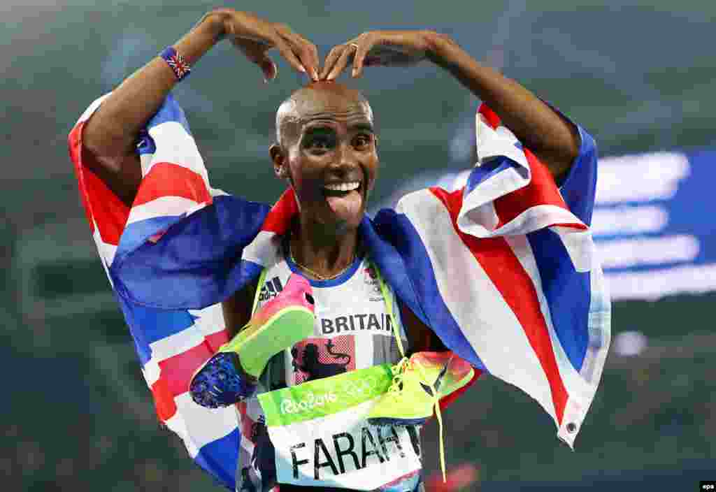 Mo Farah of Britain celebrates after winning the men's 5,000-meter final, his second in succession. He is Britan's most successful Olympic track-and-field athlete of all time.Kenyan-born American Paul Chelimo took silver, while Ethiopia's Hagos Gebrehiwet claimed bronze.