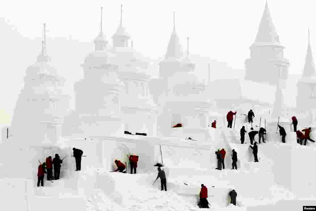 Chinese craftsmen make a snow castle at a park in Changchun, Jilin Province. (Reuters/China Daily)