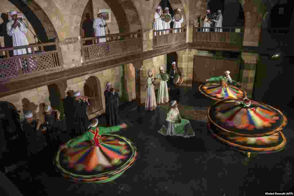 Egyptian dancers perform the Tanoura during the holy fasting month of Ramadan at the El-Ghuri Culture Palace in Cairo. (AFP/Khaled Desouki)