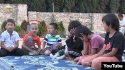 """Скриншот видеозаписи о детях """"казахстанских джихадистов в Сирии""""."""