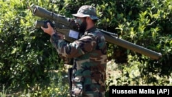 A Hizballah fighter holding an Iranian-made antiaircraft missile (file photo)