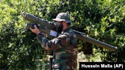 A Hizballah fighter in Lebanon holds an Iranian-made antiaircraft missile on the border with Israel. (file photo)