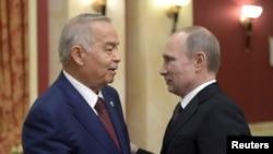 Президент Узбекистана Ислам Каримов (слева) и президент России Владимир Путин. Сочи, февраль 2014 года.