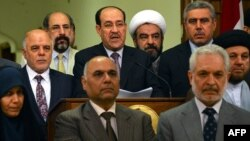 المالكي وسط إئتلاف دولة القانون يعلن تخليه عن الترشح لرئاسة الحكومة