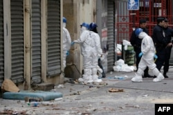 French forensics teams at work outside a building in the northern Paris suburb of Saint-Denis on November 19