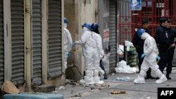 Forensics of the French police are at work outside a building in the northern Paris suburb of Saint-Denis, November 19, 2015