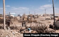 Бедное поселение в пустыне к северу от Ашгабата.