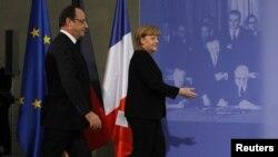 Angela Merkel şi Francois Hollande la ceremoniiile de la Berlin