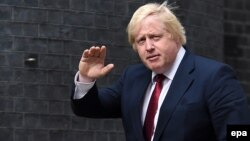 New U.K. Foreign Secretary Boris Johnson arrives at No. 10 Downing Street after being summoned by new British Prime Minister Theresa May in London on July 13.